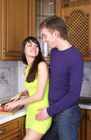 Young couple cooking at home kitchen together