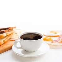 Breakfast with coffee on table