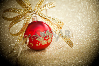 Christmas ball with golden ribbon