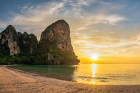 Tropical islands sunset view with ocean sea water and sand beach at Railay Beach, Krabi Thailand nature landscape