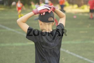 Goalkeeper with gloves. School football.