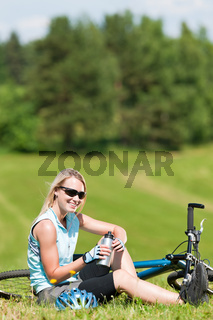 Sport mountain biking girl relax in meadows