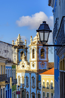 Colorful colonial houses facades and historic church towers in baroque and colonial style