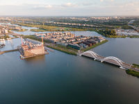 Aerial drone video of the Enneus Heermabrug in Amsterdam, The Netherlands going to Ijburg and Steigereiland Amsterdam Oost east.