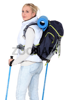 Female walker with poles and a backpack