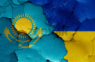 flags of Kazakhstan and Ukraine painted on cracked wall