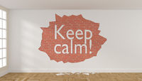 Room with crumbling plaster on the wall and the words Keep calm
