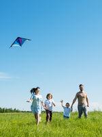 Happy family fly a kite
