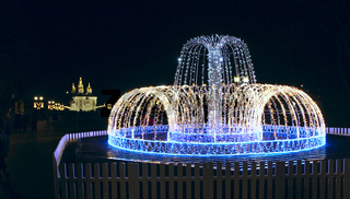 Artificial fountain made of LEDs with colored lights. Colorful New Year garlands