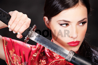 woman holding katana weapon