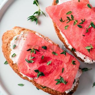 Toasts with watermelon, soft cheese and thyme