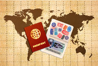Two passports with EU visa on ancient world map on old textured paper