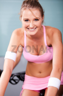 Young woman smiling doing cardio exercise