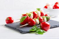 Caprese salad on wooden skewers.