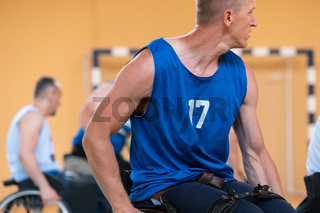 disabled war veterans in action while playing basketball on a basketball court with professional sports equipment for the disabled