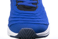 Part of a blue sneaker made of fabric with laces. A fragment of sports shoes.