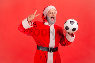 Emotional aged santa clause on red background.