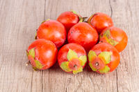 persimmons fruit on wooden table