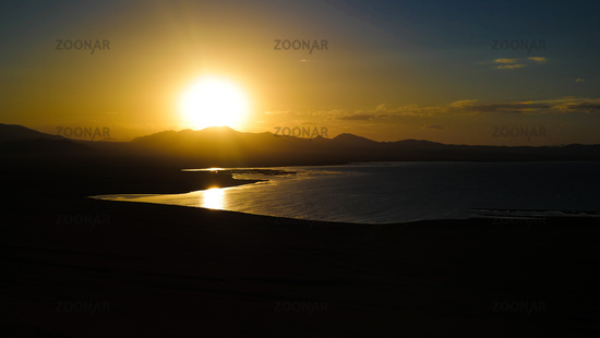 Panorama of Song Kul lake at the sunset, Kyrgyzstan