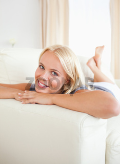 Smiling woman posing lying