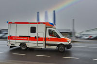 Ambulance of the rescue service in motion.