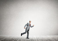 King businessman in elegant suit running in empty room