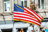 USA american flag on city street