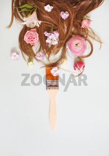 Brush and flowers near hair