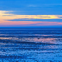 Blue hour in the Lower Saxony Wadden Sea off Cuxhaven Sahlenburg at low tide, Germany