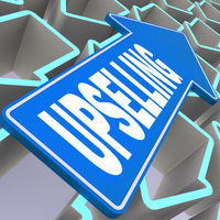 Upselling word with blue arrow
