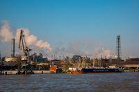 Binnenvaart, Translation Inlandshipping on the river Rhein Krefeld Netherlands , during sunset hours, Gas tanker vessel oil and gas transport Germany.