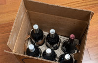 Open box or case of six bottles of wine after home delivery