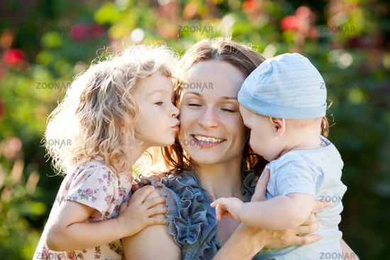 Happy woman with child and baby
