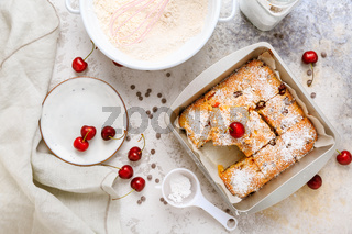 Homemade cherry sponge cake with chocolate drops with ingredients