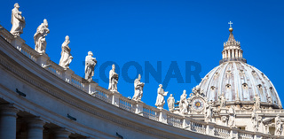 Decoration of statues on Saint Peter Cathedral with the Cupola in background - Rome, Italy