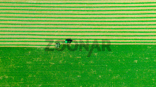 Aerial view of tractor as tow lawn mower machinery behind
