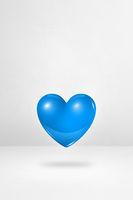 3D blue heart on a white studio background