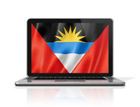 Antigua and Barbuda flag on laptop screen isolated on white. 3D illustration