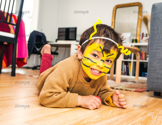 Little boy with bee face paint