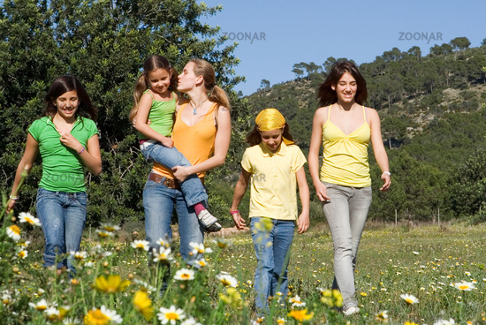 group of healthy girls or sisters walking in count