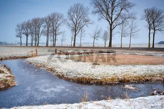 frozen canal in Dutch farmland