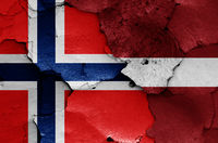 flags of Norway and Latvia painted on cracked wall