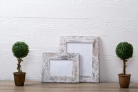 Composition of white cards in frames with copy space and decorations on white background