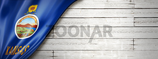 Kansas flag on white wood wall banner, USA