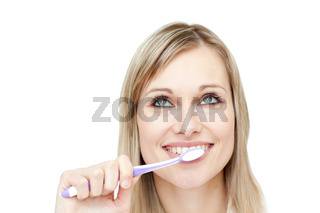 Portrait of an attractive woman brushing her teeth