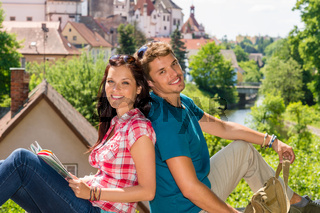 Young happy couple visit city holiday trip
