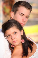 young couple with serious sad unhappy faces