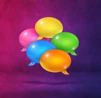 multicolor speech bubbles on purple square background