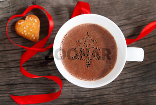 Mug of hot chocolate or cocoa with cookies