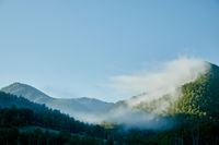 mountain sunrise in the morning with fog